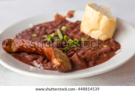 Sausage on Read Beans and Rice with bread - stock photo