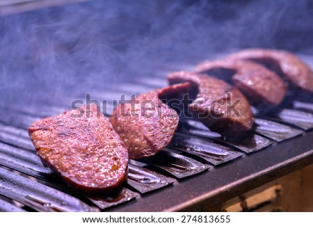 Sausage on the barbecue. - stock photo