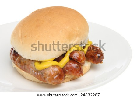 Sausage roll with mustard - stock photo