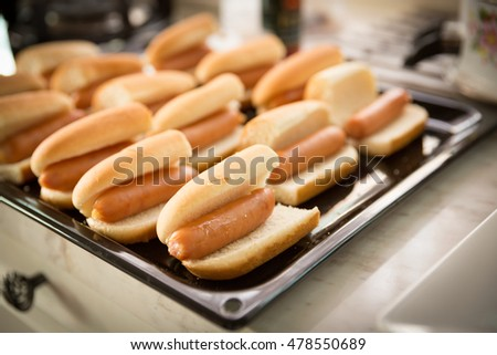 Sausage sandwich in tray ready for bake, Hotdogs in tray on the kitchen counter ready for bake (selective focus)