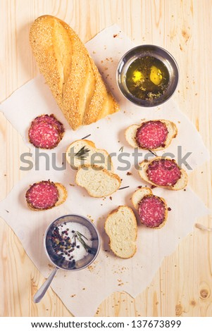 Sausage sandwich on wooden background top view - stock photo