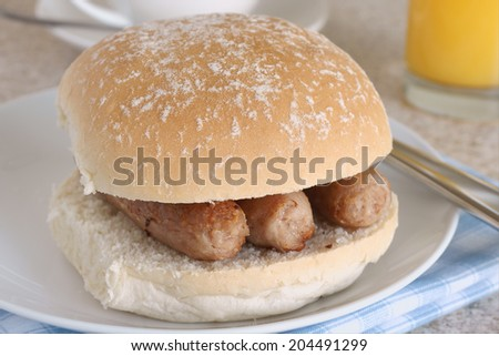 Sausage sandwich or sausage bap a favourite British snack - stock photo