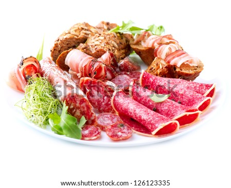 Sausage. Various Italian Ham, Salami and Bacon isolated on a White Background
