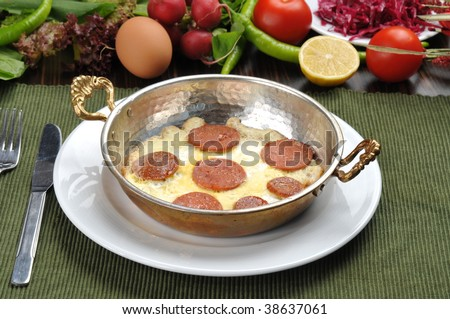 sausage with egg in copper pan turkish meal - stock photo