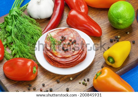 Sausage with  vegetables and herbs on the table  - stock photo