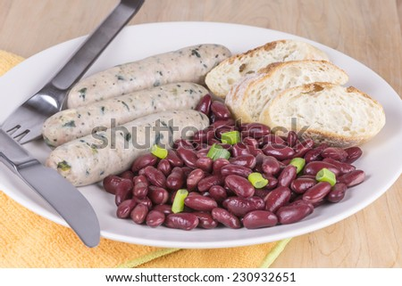Sausages and beans with bread - stock photo