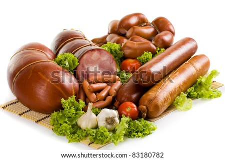 Sausages and ham with lettuce, garlic and tomatoes - stock photo