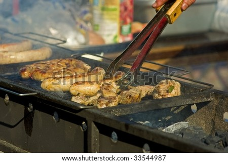 Sausages and meat on the grill - stock photo