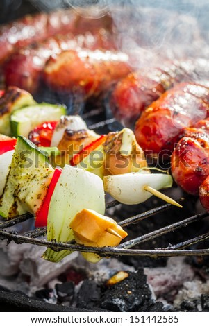 Sausages and skewers on the grill - stock photo