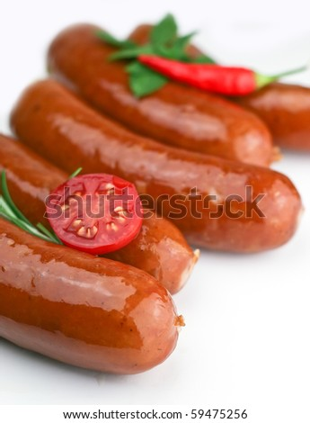 Sausages arranged with spice`s on white board, minimal - stock photo