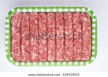 Sausages made with pork and veal meat in a tray isolated on a white background - stock photo