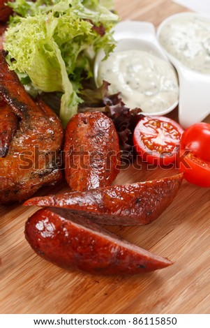 sausages on a wooden cutting board - stock photo