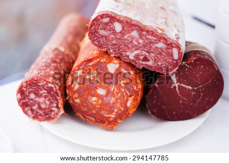 Sausages on dish - stock photo