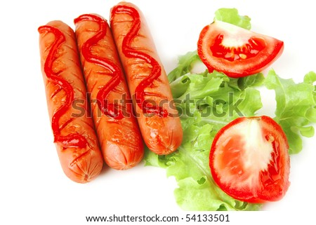 sausages served with ketchup salad and tomato - stock photo