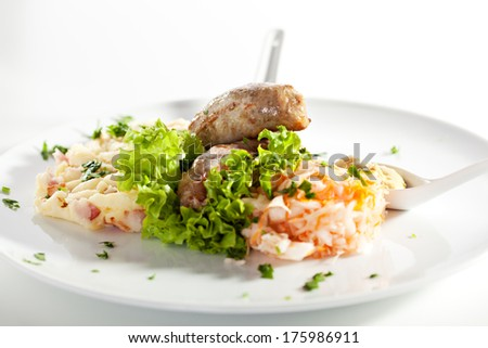 Sausages with Mashed Potatoes and Sauerkraut - stock photo