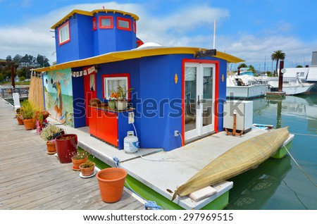 SAUSALITO, CA - MAY 21 2015:Colorful houseboat in Sausalito California.Sausalito known for it's unique houseboat community that consists of more than 400 houseboats of various shapes, colors and sizes - stock photo