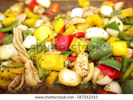 Sautee of mixed vegetables and seafood with black pepper.
