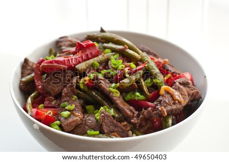Sauteed beef with beans and red pepper - stock photo
