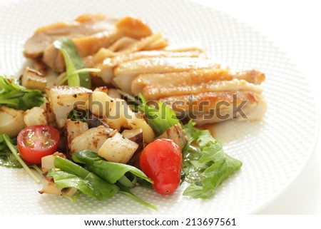 sauteed chicken served with  lotus root and baby spinach salad