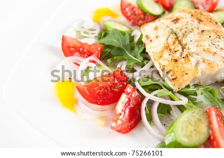 Sauteed Cod on Bed of Greens and Colorful Vegetables - stock photo
