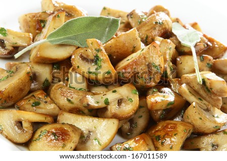 Sauteed mushrooms with herbs - stock photo