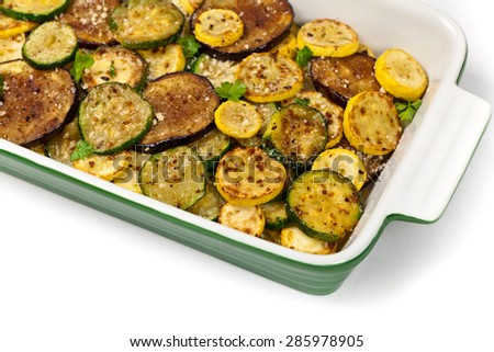 Sauteed Vegetables Eggplant, Squash, and Zucchini with Parmesan Cheese on white background. Selective focus. - stock photo