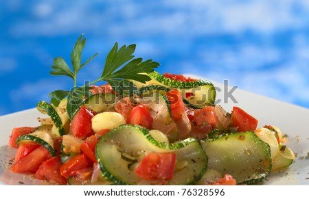 zucchini slices, tomato cubes, onion and cooked corn grains with dried ...