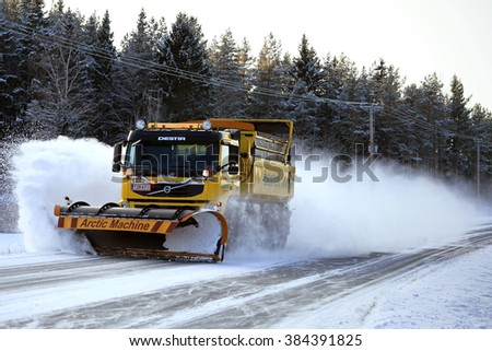 SAUVO, FINLAND - JANUARY 17, 2016: Volvo FM road maintenance truck equipped with Arctic Machine snowplow clears a highway. Destia takes care of the winter maintenance of the Finnish roads.  - stock photo