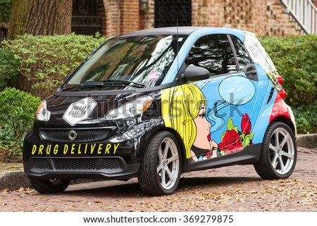 SAVANNAH, GA - JANUARY 6: Colorfully painted car used for local drug deliveries, photographed on January 6, 2016 in Savannah, Georgia - stock photo