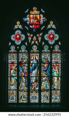 SAVANNAH, GA USA Stained glass window from The Cathedral of Saint John the Baptist in downtown Savannah.  - stock photo