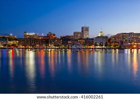 Savannah, Georgia along the waterfront at night - stock photo