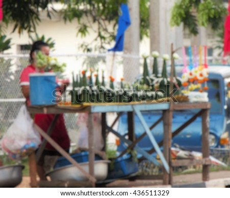 Savannakhet Province, Laos - Sep 9, 2015 : Blur Handmade Flowers offering to Buddha in Temple at Laos on September 9, 2015 in Savannakhet, Laos - stock photo