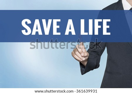 Save a Life word on virtual screen touch by business woman blue background - stock photo