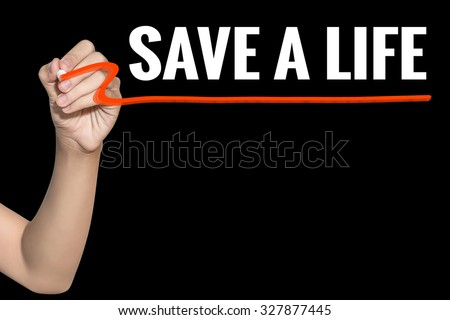 Save a Life word write on black background by woman hand holding highlighter pen - stock photo