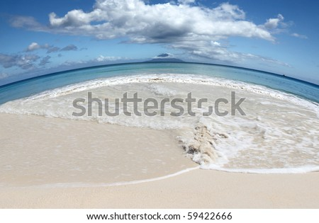 Save Earths Beaches global warming concept with stunning shore in the shape of our planet with island on the central Horizon - stock photo