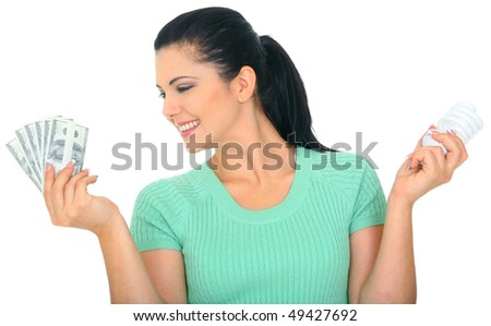 save energy concept. young woman holding bulb and money