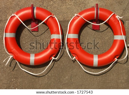 Save me - life belts at a swimming pool - stock photo