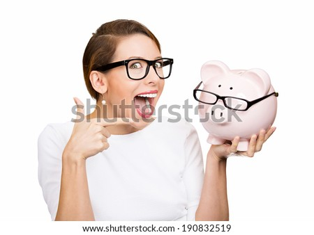 Save money. Closeup portrait, headshot young surprised, excited, happy business woman over savings on buying eyewear. Piggy bank wearing glasses isolated white background. facial expressions, emotion - stock photo