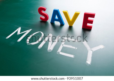 Save money concept, message words on blackboard - stock photo