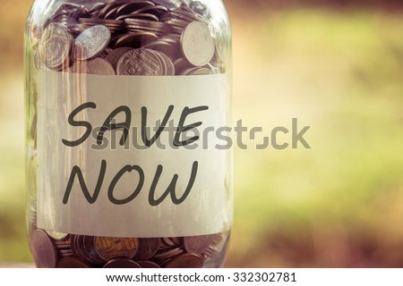 save money for investment concept money in the glass with filter effect retro vintage style - stock photo
