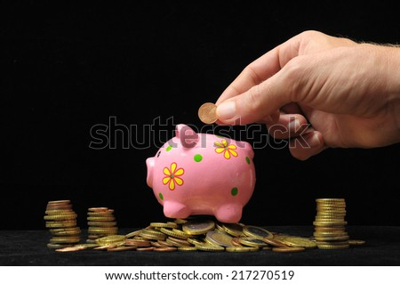 Save Money with One Pink Pig Piggy Bank - stock photo