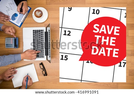SAVE THE DATE Business team hands at work with financial reports and a laptop - stock photo
