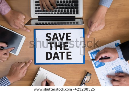 SAVE THE DATE  Business team hands at work with financial reports and a laptop, top view - stock photo