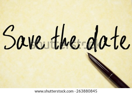 save the date text write on paper  - stock photo