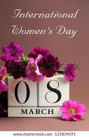 Save the date white block calendar for International Women's Day, March 8, decorated with pink and purple flowers against a pink purple background.