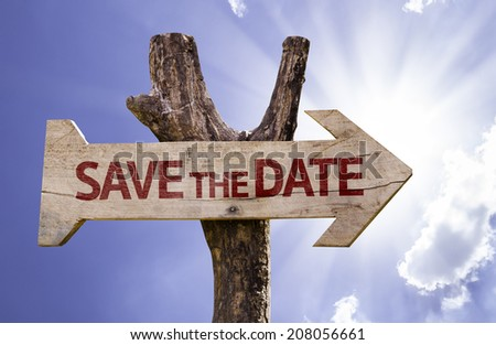Save the Date wooden sign on a beautiful day - stock photo