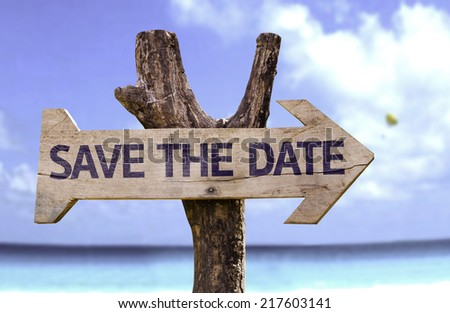 Save The Date wooden sign with a beach on background - stock photo