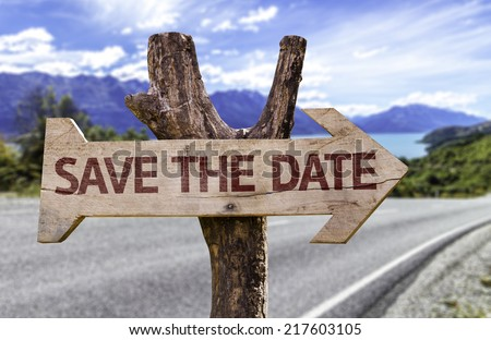 Save The Date wooden sign with a road background - stock photo