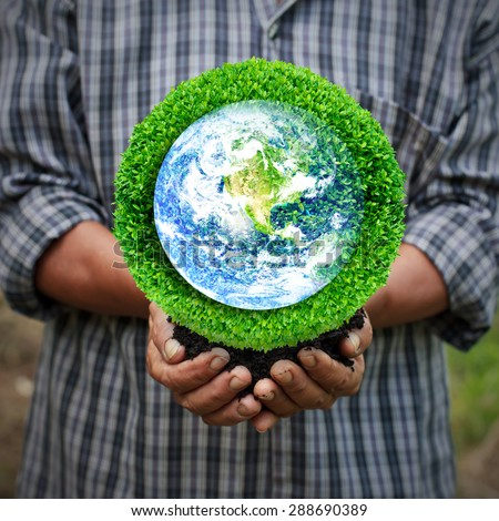 Save the earth by trees. Human hand holding global in soil with green tree for think earth concept. Elements of this image furnished by NASA. - stock photo