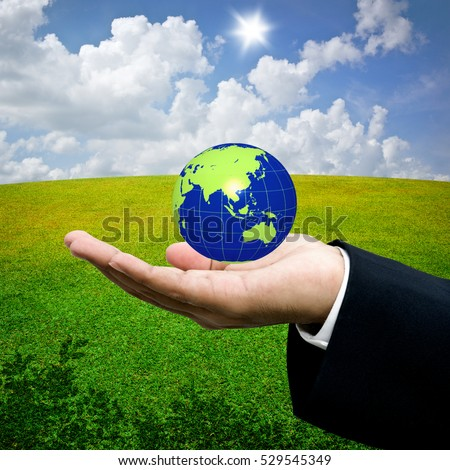 Save the earth concept, The earth in hand